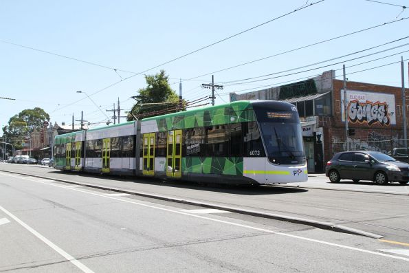 E2.6073 heads south on route 96 along Nicholson Street at North Fitzroy depot