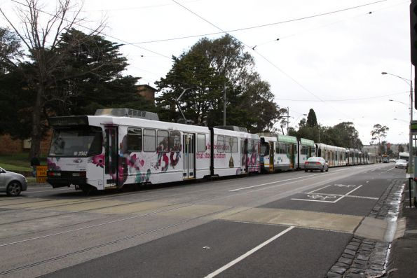 Four B2s and two D2 class trams sit in the Showgrounds Loop to collect Melbourne Cup patrons after the race