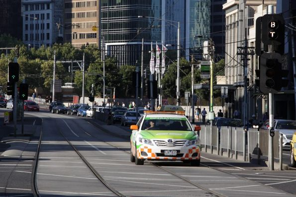 Yarra Trams operations car heads along Queensbridge Street at Power Street