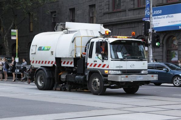 Yarra Trams street sweeper vacuuming sand out of the flangeways