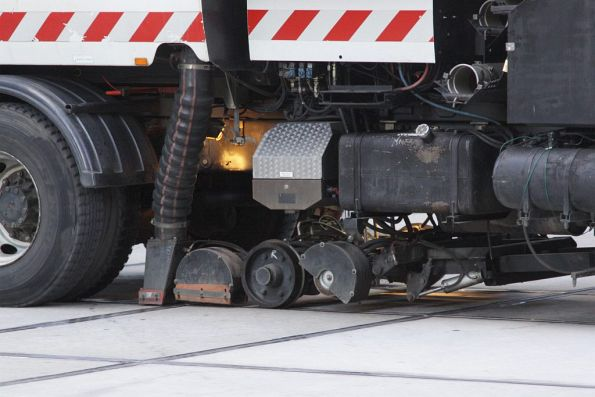 Detail of the vacuum attachment on the hi-rail street sweeper