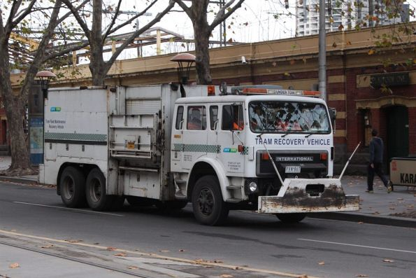 Recovery truck R10 heads between jobs outside Banana Alley on Flinders Street