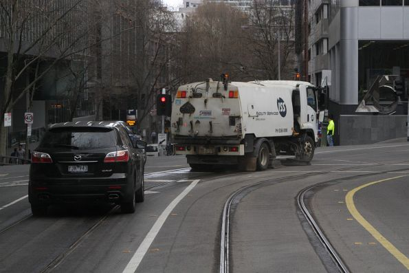 Street sweeper cleans the rail flanges at Flinders Lane and William Street