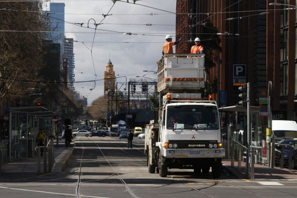 Overhead inspection crew head west at Flinders and Spencer Street