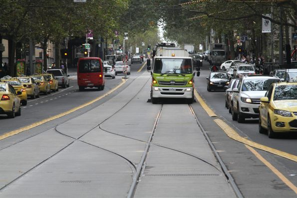 Yarra Trams street sweeper cleaning the tram tracks on Collins Street