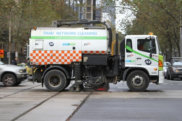 Yarra Trams street sweeper cleaning the tram tracks on William Street