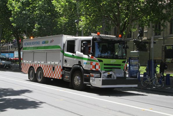 Yarra Trams recovery truck following close behind a defective tram at Swanston and Flinders Street