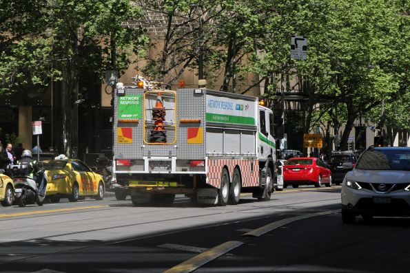 Yarra Trams recovery truck heads west at Collins and Spring Street
