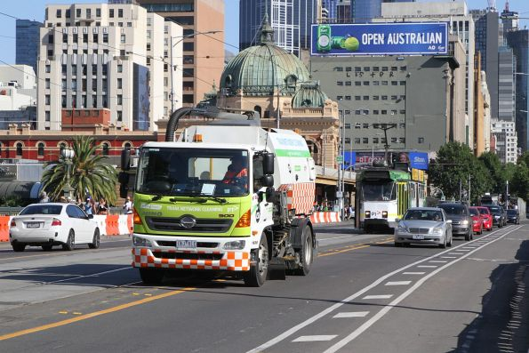 Yarra Trams track cleaning truck heads south over Princes Bridge