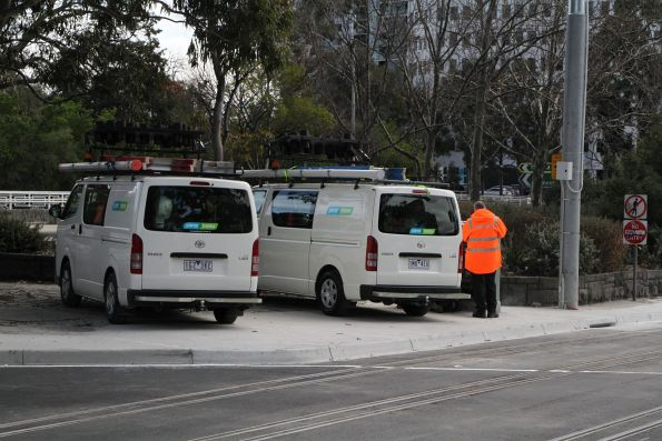 Yarra Trams staff attend to the new pointwork at St Kilda Junction