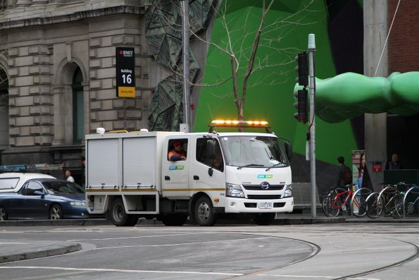 Yarra Trams maintenance truck heads south at Swanston and La Trobe Street