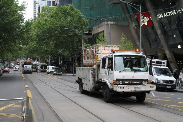 Yarra Trams overhead platform truck heads west at Collins and Spencer Street