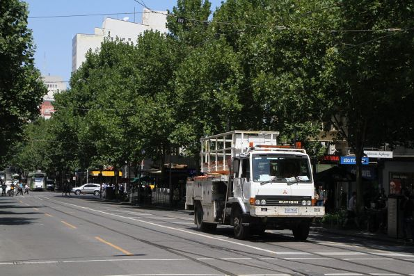 Yarra Trams overhead platform truck heads north at Swanston and Lonsdale Street