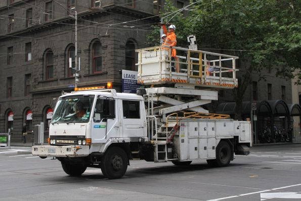 Yarra Trams crew inspect the overhead wires at Bourke and William Street