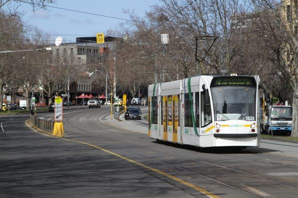 D1.3526 on route 72 heads north on St Kilda Road at Domain Interchange