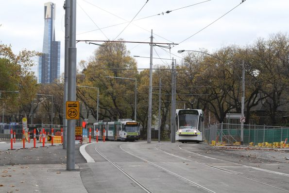 Trams negotiate the slewed tram tracks along St Kilda Road north of Toorak Road