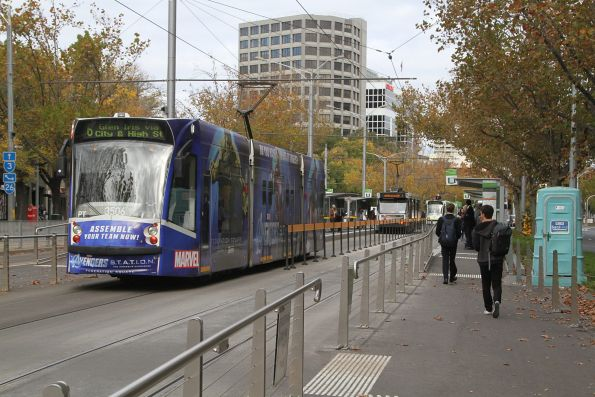 D1.3506 advertising 'Avengers' heads south on route 6 at St Kilda Road and Toorak Road