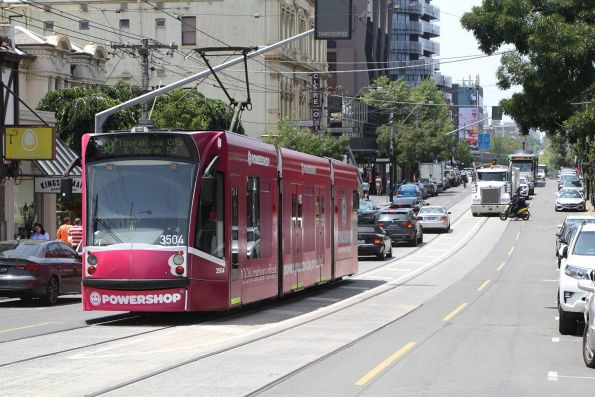 D1.3504 advertising 'Powershop' heads east on route 58 at South Yarra station