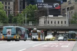 Trams, buses and taxis on Queens Bridge over the Yarra River