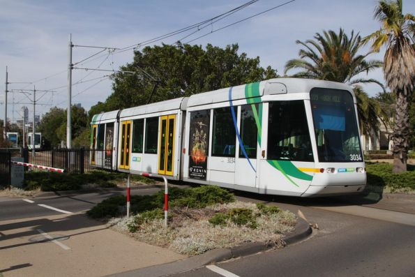 Now on the short single track section, C.3034 arrives into the Port Melbourne terminus