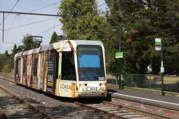 Arriving at the Graham Street stop, C.3001 advertising 'L'Oreal' makeup