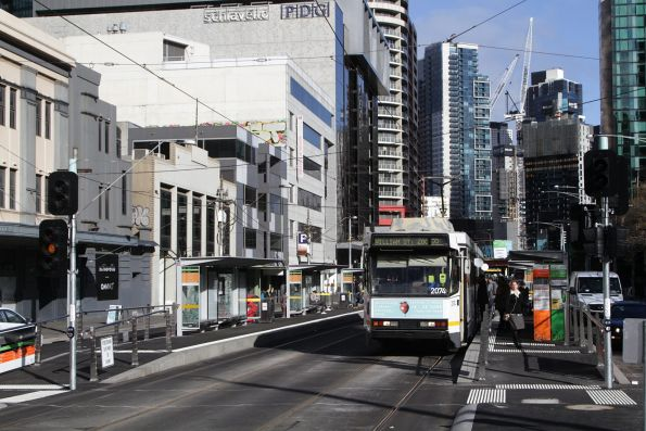 B2.2074 heads north on a route 55 service at the combined tram and bus stop on Queensbridge Street