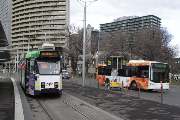 Z3.230 waiting to depart Domain Interchange with a route 55 service, with a Transdev bus on route 219 passing by