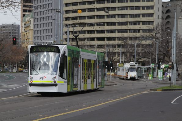 D1.3518 heads south on a route 8 service at Domain Interchange