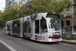 D1.3510 advertising 'Kiis 101.1' heads north at St Kilda Road and Coventry Street