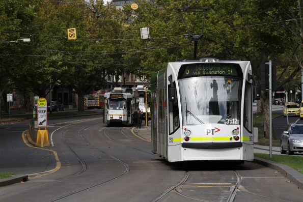 D1.3512 and Z3.128 head north on St Kilda Road at Domain Interchange