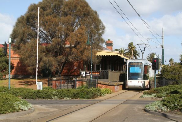 C.3002 on route 109 waits for the level crossing to close at Beach Street, Port Melbourne