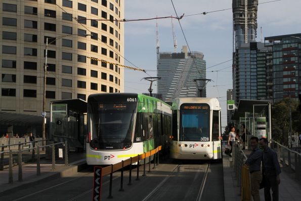 E2.6061 on route 96 passes C.3028 on route 109 along Clarendon Street at Crown Casino