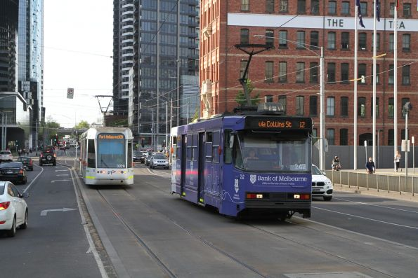 A1.242 advertising 'Bank of Melbourne' on route 12 passes C.3028 on route 109 at Clarendon Street Junction