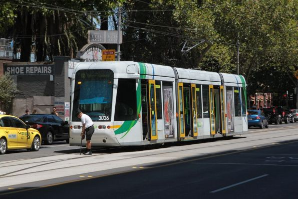 Driver of C.3036 throws the points of the Elizabeth Street crossover on Flinders Street