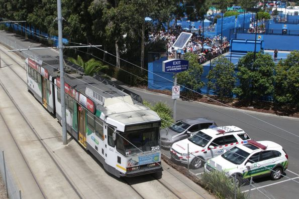 B2.2040 passes the outside courts at Melbourne Park on a citybound shuttle