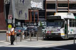 Driver of B2.2054 throws the points at the King Street crossover on Flinders Street