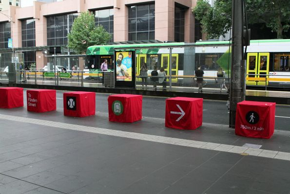 Signage at Southern Cross Station directing tennis fans to trams on Flinders Street