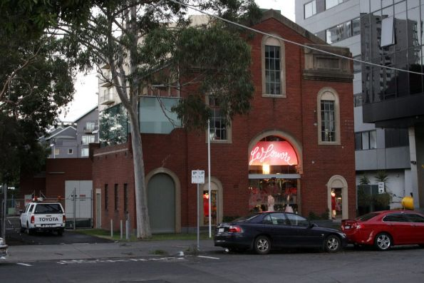 Substation 'Sy' on Daly Street, South Yarra. Original substation now occupied by a clothes store, new substation hiding in the background