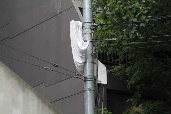 Some sort of sheet covering the traction feeder cables at Collins and Spencer Street