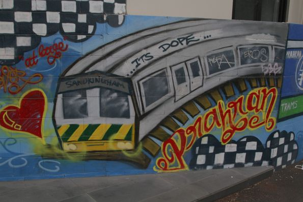 Met liveried train on a mural at Prahran station