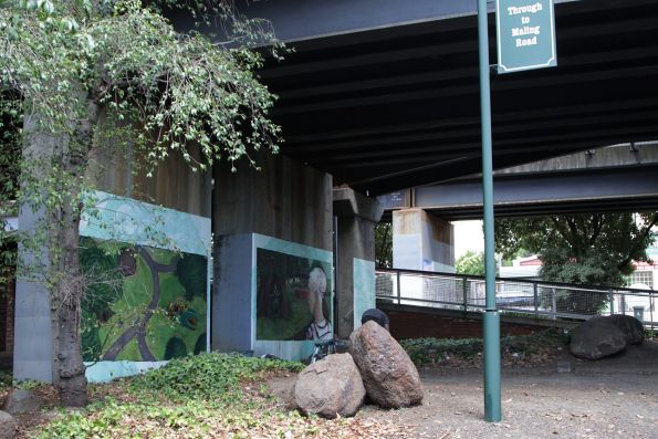 Painting murals on the concrete bridge piers at Canterbury station