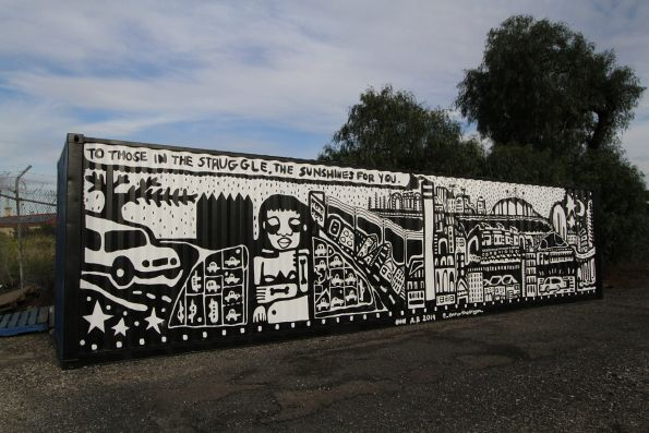 'To those in the struggle, the sunshine's for you' mural by Aretha Stewart Brown at Footscray station