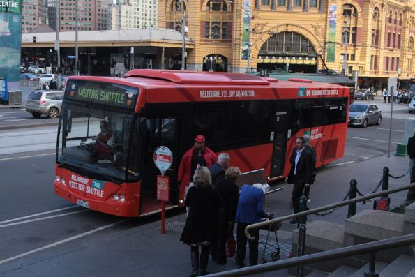 Melbourne Visitor Shuttle waiting for passengers outside Federation Square, with bus #42 rego 1042AO