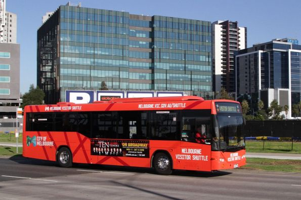 Melbourne Visitor Shuttle bus #43 1043AO on Footscray Road, passing the back blocks of Docklands