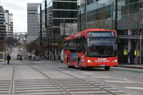 Melbourne Visitor Shuttle bus #42 1042AO heads east on Collins Street at Batman's Hill