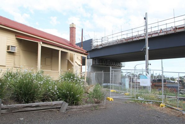 New bridge for Melton Highway towers over the disused station building at Sydenham