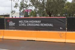 'Melton Highway level crossing removal' banner beside the work site