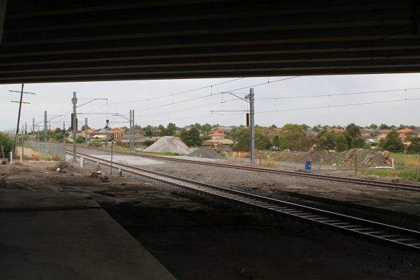 Railway passes beneath the completed Melton Highway bridge