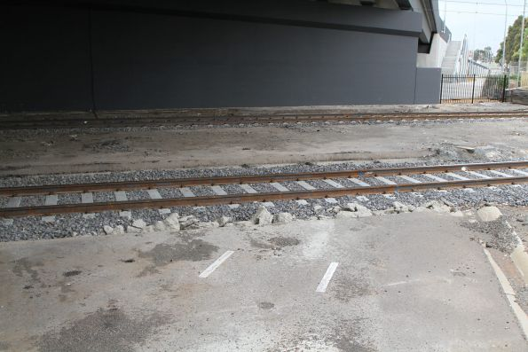 Remains of the former level crossing at Melton Highway