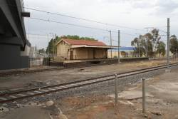Original station building at Sydenham overshadowed by the completed Melton Highway bridge